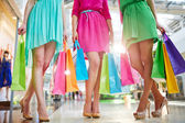 Women in bright dresses in mall — Stock Photo
