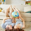 Couple choosing place on globe where to travel — Stock Photo #76984357