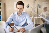 White collar worker sitting by desk — Stock Photo