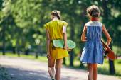Little girls with skateboards — Stock Photo