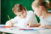 Classmates drawing at lesson — Stock Photo