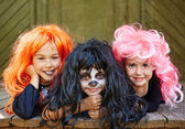 Happy girls in bright wigs — Stock Photo
