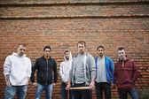 Group of hooligans near brick wall — Stock Photo