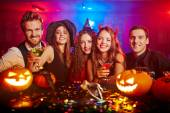 Young people cheering at Halloween — Stock Photo