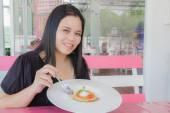 Girl eating Custard caramel — Stock Photo