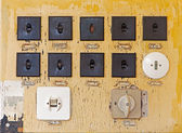 Old electric switches on the wall — Stock Photo