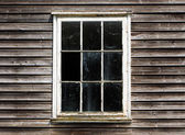 Old window with a curtain of the wooden house — Stock Photo