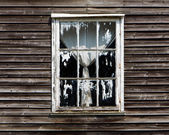 Old window with a curtain of wooden house — Stock Photo