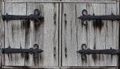 Old wooden shutters of the farm house — Stock Photo