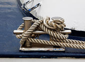 Bollard on the ship and tied rope — Stock Photo