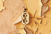 Old  outlet and cable on a decrepit wall — Stock Photo