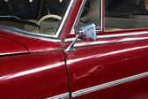 Part of the old red car and car mirror — Stock Photo