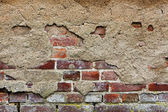 Old plaster on red brick wall — Stock Photo