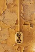 The Old electrical outlet on a decrepit wall — Stock Photo