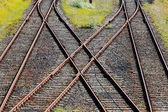 Railroad crossing on gravel in  the sunshine — Stock Photo