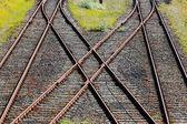 Railroad crossing on gravel in  the sunshine — Foto Stock