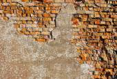 Old plaster on red brick wall — Photo