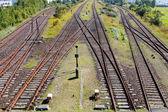 Railroad crossing on gravel in  sunlight — Foto Stock