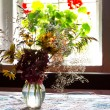 Bouquet of wild flowers in a vase on the table — Stock Photo #56125701