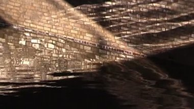 Brick wall in running water and sunbeams — Stock Video