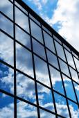 Reflection of the sky and clouds in the windows of  building — Stock Photo