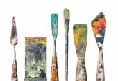 Various palette knives and a brush on a white background — Stock Photo