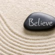 Black stone with the inscription Believe — Stock Photo #52814235