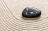 Black stone with the inscription Love — Stock Photo