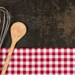 Old baking tray with red checkered table cloth and baking utensils — Stock Photo #54297843