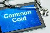 Tablet with the text Common Cold on the display — Stock Photo