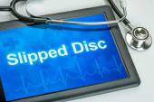 Tablet with the text Slipped disc on the display — Stock Photo