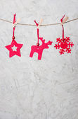 Three christmassy felt figures — Stock Photo