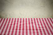 Background with checkered tablecloth and a rustic wall — Stock Photo