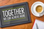 Tablet on a desk - Together we can achieve more — Stock Photo