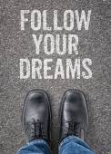Text on the floor - Follow your dreams — Stock Photo