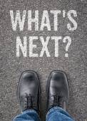 Text on the floor - Whats next — Stock Photo