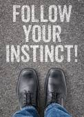 Text on the floor - Follow your instinct — Stock Photo