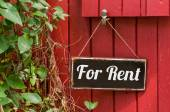 Old metal sign with the inscription For Rent — Stock Photo