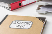 A folder with the label Occupational safety — Stock Photo