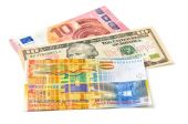 Euro, Dollar and Swiss Franc on a white background — Stock Photo