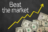 Text on blackboard with money - Beat the market — Foto de Stock