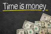 Text on blackboard with money - Time is money — Foto de Stock