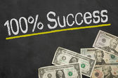 Text on blackboard with money - 100 percent success — Foto de Stock
