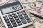 Calculator with money - Profit — Stok fotoğraf