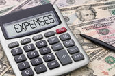 Calculator with money - Expenses — Stock Photo