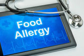 Tablet with the diagnosis food allergy on the display — Stock Photo