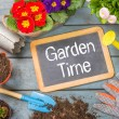 Blackboard on a plant table with garden tools - Garden Time — Stock Photo #68174975