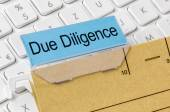 A brown file folder labeled with Due Diligence — Stock Photo