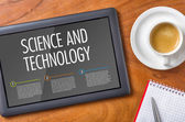 Tablet on a wooden desk - Science and Technology — Stock Photo