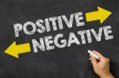 Positive or Negative written on a blackboard — Stock Photo